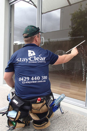 Window cleaner in Mt Eliza using squeegee