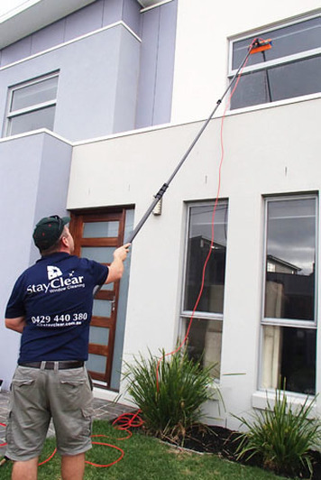Window cleaner in Blairgowrie using water fed pole