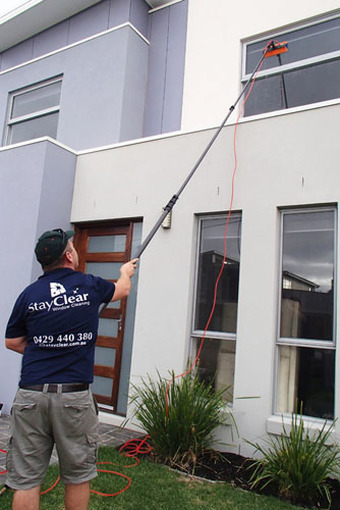 Safety beach window cleaner using water fed pole